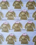 Beret Bunny stickers on wood
