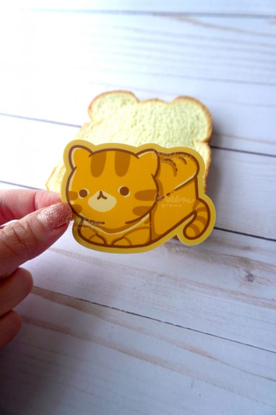 catloaf sticker with bread in the background
