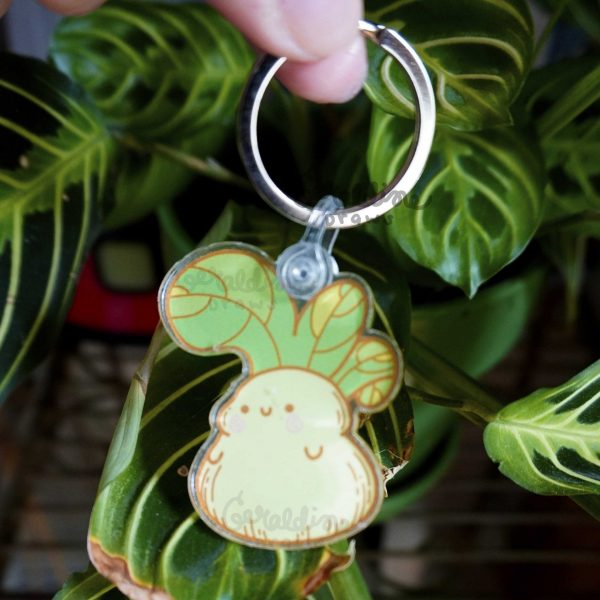 bok choy keychain hanging in front of plants